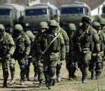 Armed men, believed to be Russians, march at their camp near the Ukrainian military base in Perevalnoye outside Simferopol March 17, 2014. Ukraine's parliament, seeking to boost the country's military force in the face of Russia's takeover of the Crimea peninsula, endorsed a presidential decree on Monday to carry out a partial mobilisation involving 40,000 reservists. REUTERS/David Mdzinarishvili (UKRAINE - Tags: POLITICS CIVIL UNREST MILITARY)