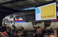 The reconstructed airplane serves as a backdrop during the presentation of the final report into the crash of July 2014 of Malaysia Airlines flight MH17 over Ukraine, in Gilze Rijen, the Netherlands, October 13, 2015. The Dutch Safety Board, issuing long-awaited findings on Tuesday of its investigation into the crash of a Malaysian passenger plane over eastern Ukraine, is expected to say it was downed by a Russian-made Buk missile but not say who was responsible for firing it. Buk manufacturer Almaz-Antey scheduled a separate press conference on Tuesday at which it may attempt to discredit the Safety Board findings. REUTERS/Michael Kooren      TPX IMAGES OF THE DAY      - RTS48B9