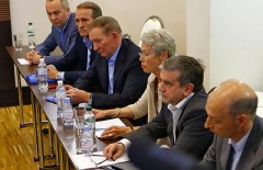 Former Ukrainian President Leonid Kuchma (3rd L), OSCE Ambassador Heidi Tagliavini (3rd R), Russian Ambassador to Ukraine Mikhail Zurabov (2nd R), Ukrainian politician Viktor Medvedchuk (2nd L) and other officials attend talks with representatives of self-proclaimed Donetsk and Luhansk People's Republics in Donetsk June 27, 2014. Ukrainian separatists agreed on Thursday to resume peace talks to end the conflict in the east, but President Petro Poroshenko warned he might not extend a ceasefire beyond Friday night if their gesture was aimed only at buying time. REUTERS/Shamil Zhumatov (UKRAINE - Tags: POLITICS CIVIL UNREST) - RTR3W3RD