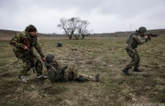 epa04689230 Ukrainian servicemen of the 'Donbass battalion' in action during a training session at a shooting range near the eastern city of Mariupol, Ukraine, 01 April 2015. Eastern Europe is seeing an upswing in military exercises, people training to be reservists and talk of resuming conscription. Some countries have even gone ahead and brought back the draft because Russia's recent behaviour has the Baltic republics and Central Europe rattled. German Chancellor Angela Merkel on 01 April urged the warring parties in Ukraine to follow through on their February truce and implement the rest of the promises aimed at ending the conflict.  EPA/ROMAN PILIPEY