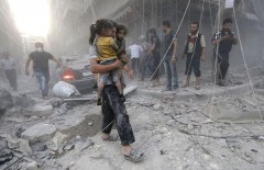 "A Syrian man carries two girls covered with dust following a reported air strike by government forces on July 9, 2014 in the northern city of Aleppo. According to the Syrian Observatory for Human Rights, by May some 2,000 civilians including 500 children had been killed in the daily air strikes, which rights groups have condemned as a ""war crime"" for failing to discriminate between military and civilian targets. AFP PHOTO /AMC/ZEIN AL-RIFAI        (Photo credit should read ZEIN AL-RIFAI/AFP/Getty Images)"
