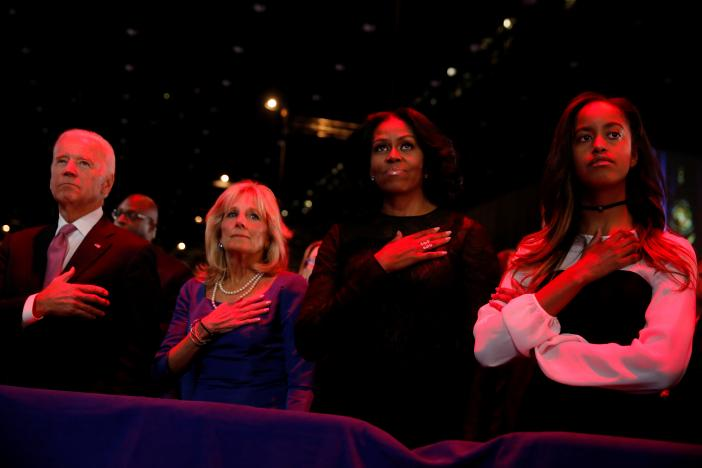 Vice President Joe Biden, his wife Jill Biden, first lady Michelle Obama and her daughter Malia Obama stand for the national anthem before President Barack Obama delivers his farewell address in Chicago, Illinois. REUTERS/Jonathan Ernst