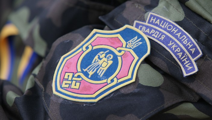 "ITAR-TASS: KIEV, UKRAINE. MARCH 17, 2014. Division patch bears the name of the National Guards Unit of Ukraine. Enlistment for household troops underway in Kyiv in the wake of the Crimea's vote to leave Ukraine. 96.77 percent of voters in Crimea chose to join Russia in a referendum on March 16, 2014.  (Photo ITAR-TASS / Artyom Geodakyan)  Украина. Киев. 17 марта. Нашивка ""Национальная гвардия Украины"". Фото ИТАР-ТАСС/ Артем Геодакян"