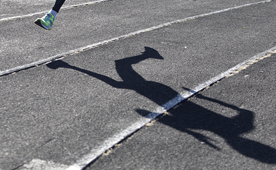 A sportsman casts a shadow on a race track while training at a local stadium in the southern city of Stavropol, Russia, November 10, 2015. The Russian Sports Ministry said on Tuesday it was open for closer cooperation with the World Anti-Doping Agency (WADA) in order to eliminate any irregularities committed by the Russian anti-doping watchdog and its accredited laboratory. On Monday an anti-doping commission report alleged widespread corruption in Russia, triggering one of the biggest doping scandals in sporting history. REUTERS/Eduard Korniyenko - RTS6ARP