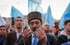 epa04755705 Crimean Tatars attend a mourning ceremony at the Independence Square in Kiev, Ukraine, 18 May 2015. Crimean Tatars mark the 71th anniversary of the forced deportation of Crimean Tatars from Crimea by the Soviet Union in 1944. In March 2014 Russian forces seized control of government buildings and airports in Crimea and organized the events leading to Russia's annexation of Crimea.  EPA/ROMAN PILIPEY