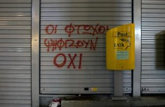 """A slogan reads """" The poor vote for NO"""" next to a mailbox outside a closed Hellenic Post branch in Athens, Greece, March 20, 2017. REUTERS/Alkis Konstantinidis"""