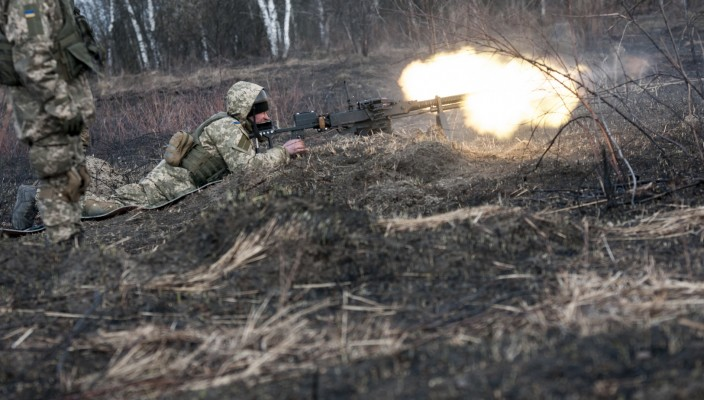 A Ukrainian soldier with the 1st Battalion, 28th Mechanized Infantry Brigade fires a modified DSHsK heavy machine gun to cover the advance of fellow 1-28 soldiers during a live-fire training exercise at the Yavoriv Combat Training Center on the International Peacekeeping and Security Center, near Yavoriv, Ukraine, on March 16.  The live-fire exercise is part of a block of instruction taught by Ukrainian combat training center staff, who are mentored by members of the Joint Multinational Training Group-Ukraine. JMTG-U is a coalition made up of servicemembers from the Canada, Denmark, Lithuania, Poland, the United Kingdom, the United States and Ukraine who are dedicated to developing the combat training center and building professionalism in the Ukrainian military. (Photo by Sgt. Anthony Jones, 45th Infantry Brigade Combat Team)