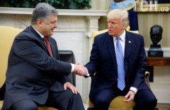 U.S. President Donald Trump shakes hands with Ukraine's President Petro Poroshenko in the Oval Office at the White House in Washington