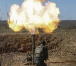 epa04697332 Recently mobilized Ukrainian paratrooper fires a mortar during a training session on the shooting range near of Perlyavka village not far of Zhytomyr, Ukraine, 09 April 2015. Russian Foreign Minister Sergei Lavrov plans to attend talks on the Ukraine crisis in the German capital Berlin, Interfax news agency reported on 09 April. Lavrov is scheduled to meet Monday with his counterparts from Germany, France and Ukraine to discuss the implementation of the Minsk peace accord for the war-torn country.  EPA/ROMAN PILIPEY