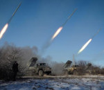 """Pro-Russian rebels stationed in the eastern Ukrainian city of Gorlivka, Donetsk region, launch missiles from Grad launch vehicles on February 18, 2015. Ukrainian troops pulled out of the hotspot eastern town of Debaltseve after it was stormed by pro-Russian rebels in what the EU said was a """"clear violation"""" of an internationally-backed truce. AFP PHOTO / ANDREY BORODULIN"""