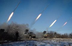 "Pro-Russian rebels stationed in the eastern Ukrainian city of Gorlivka, Donetsk region, launch missiles from Grad launch vehicles on February 18, 2015. Ukrainian troops pulled out of the hotspot eastern town of Debaltseve after it was stormed by pro-Russian rebels in what the EU said was a ""clear violation"" of an internationally-backed truce. AFP PHOTO / ANDREY BORODULIN"